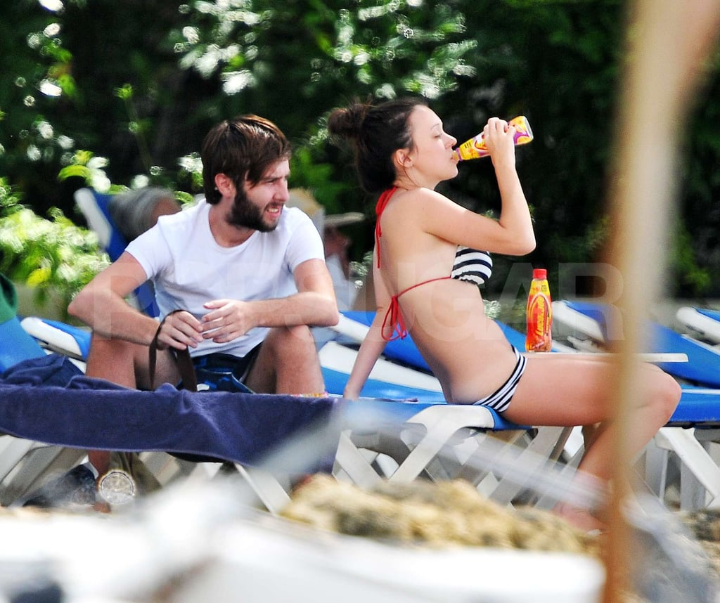 "James Buckley relaxed on the beach in Barbados with girlfriend Clair Meek yesterday. She donned a stripy bikini while James covered up. The Inbetweeners star is nothing like his character, according to Clair, who says: ""James could not be more different to Jay. He's actually quite shy and quiet, and very thoughtful. He's very respectful. He didn't come out with any outrageous chat-up lines."""