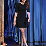 Kristen Stewart's LBD balances its stem-baring with covered sleeves and a classic fit-and-flare shape.