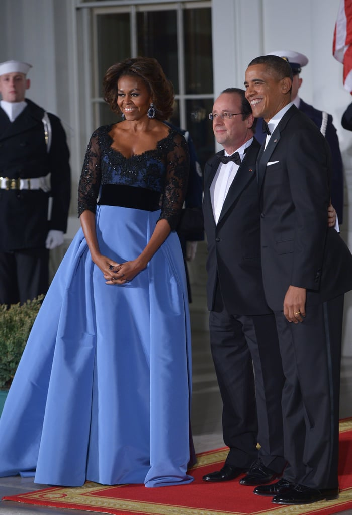 """The president and first lady welcomed French President Francois Hollande to the White House Tuesday evening for a night of diplomatic partying. Michelle looked radiant in her Carolina Herrera ball gown, once again showing support for an American designer. The Obamas pulled out all the stops for their first state dinner in two years, calling on Chelsea Clinton's wedding planner to coordinate the logistics. They set up a huge tent on the South Lawn, where guests enjoyed the """"best of American"""" cuisine that included caviar from Illinois, potatoes from Idaho, and dry-aged rib-eye beef from Colorado. For dessert, a Hawaiian chocolate-malted ganache was planned — and all the wines were American! For entertainment, Mary J. Blige was set to perform, but she wasn't the only showbiz guest. Bradley Cooper, who is fluent in French thanks to time spent studying abroad, also got an invite, as did Julia Louis-Dryfus and her French-born father, billionaire William Louis-Dreyfus. At the dinner, there wasn't dancing, however, since the newly single Hollande came stag after recently weathering an affair and a breakup. Every state dinner is a major, protocol-heavy spectacle. While Bill Clinton hosted 23 and Ronald Reagan 35, Obama has only hosted six. And one planned for last year got canceled when the Brazilian president decided to skip her trip to Washington to protest NSA spying. But tonight was all about the special French and American relationship. See photos from the symbolically important event now."""