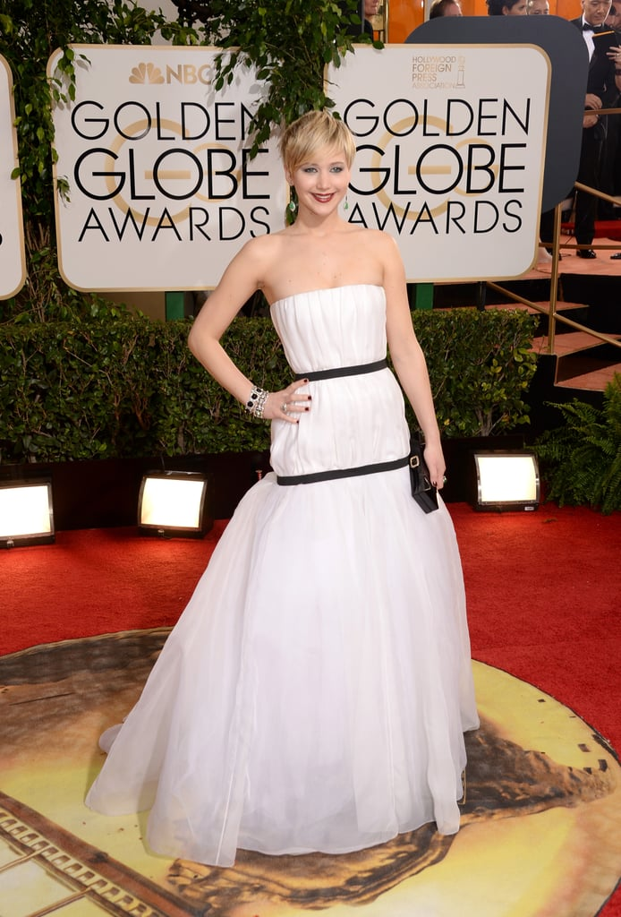 """Jennifer Lawrence walked the red carpet wearing white Dior at the 2014 Golden Globes in LA, ready to not only potentially accept an award — she's up for best supporting actress in American Hustle — but present one, too. If anyone can pull double duty, it's Jennifer, and if all goes well, we'll have another """"I bet Meryl!"""" moment on our hands like last year's Globes, or maybe rip her dress while she's thinking about cake like at the 2013 Oscars. We still have to wait and see if she'll be nominated for an Oscar this year — they'll be announced on Jan. 16 — but if we could bet, we'd bet on Jen. Keep clicking to see more of her at the Globes and make sure to vote on all of our Golden Globes polls here!"""