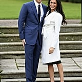 In November 2017, Meghan wore a sleek, white trench coat from Canadian label Line and a green Parosh dress to announce her engagement to Prince Harry.