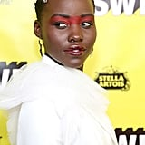 Lupita Nyong'o's Exposed Alligator Pins in 2019