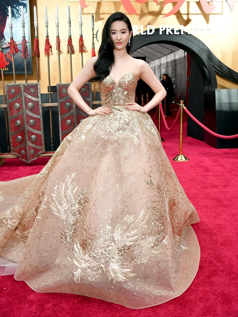 Liu Yifei Wearing Gold Elie Saab Gown at Mulan Premiere