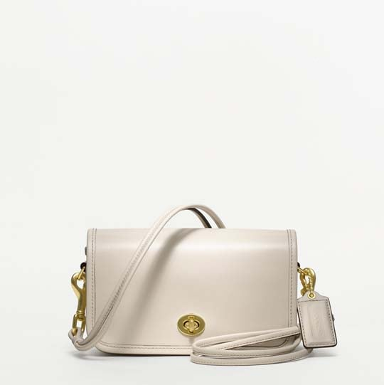 """>> When Coach first re-launched its heritage Classics collection with Net-a-Porter back in June, it stuck to a '70s color palette of mahogany, tan, navy, and deep red. The popularity of the collection must have made Coach more daring, because they're <product target=""""_blank"""" href=""""http://www.coach.com/online/handbags/-handbags_feature_coachorig-10551-10051-5000000000000052055-en?t1Id=62&t2Id=5000000000000052055&tier=2&LOC=CC1""""> just released a new set of the bags</product> — this time in bolder colors like candy red vermillion, lime, and white."""
