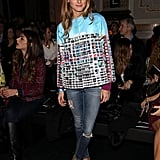 Olivia dressed the part for Matthew Williamson's show in a bright statement top, distressed denim, and Fendi heels.
