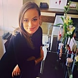 Olivia Wilde boasted a mom-to-be glow while promoting her new collection for Revlon. Source: Instagram user popsugarbeauty
