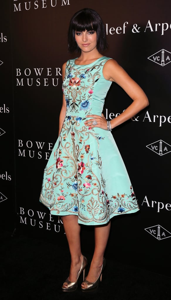 A striking aqua hue wasn't all that made Camilla Belle's Oscar de la Renta cocktail dress a standout at Van Cleef & Arpels's A Quest For Beauty Event. High-contrast floral embroidery (not to mention piles of diamonds) made the design truly dramatic.