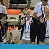 Princess Charlene, a former swimmer, and Prince Albert waved to the competitors.