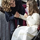 Queen Letizia greeted a young girl during an October visit to the village of Colombres.