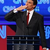 Rick Perry blows a kiss to his wife at a presidential debate in September.