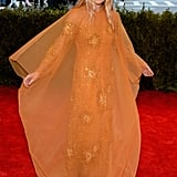 For the night's festivities, Ashley Olsen picked a vintage Dior orange beaded gown with a matching overlay that flowed flawlessly.