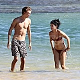 Vanessa Hudgens wore a bikini to lounge with her shirtless boyfriend.