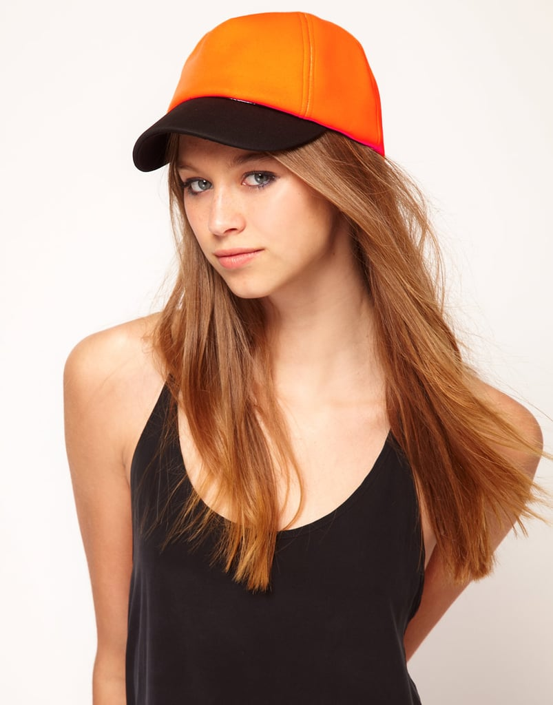 Sleek and fun, this neoprene and patent-leather piece is perfect for a beach day. ASOS Neoprene Color Block Cap ($13, originally $25)