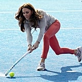 Kate Middleton took her best shot while meeting members of Great Britain's hockey team in March.