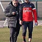 David Beckham talked to Paris Saint-Germain fitness trainers during practice Wednesday.