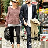 Sienna Miller held Tom Sturridge held hands while vacationing in Italy together.