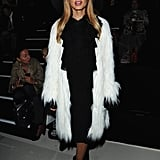 Rachel Zoe added a furry white overcoat to her all-black uniform at Elie Saab.