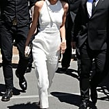 Kendall Jenner made her way around the festival in a chic white jumpsuit and cat-eye shades.
