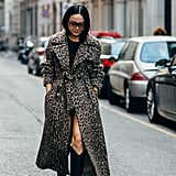 Work your wool leopard coat as a dress with cowboy boots.
