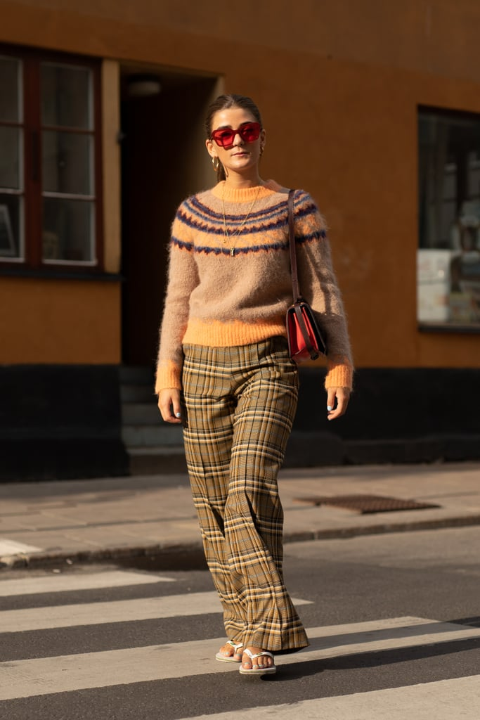 Styling a sweater and plaid pants with a white pair.