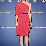 Carey posed for photos in a one-shoulder salmon-hued sheath, geometric sandals, and a gold statement bracelet at the Directors Guild of America Awards in Century City, CA.