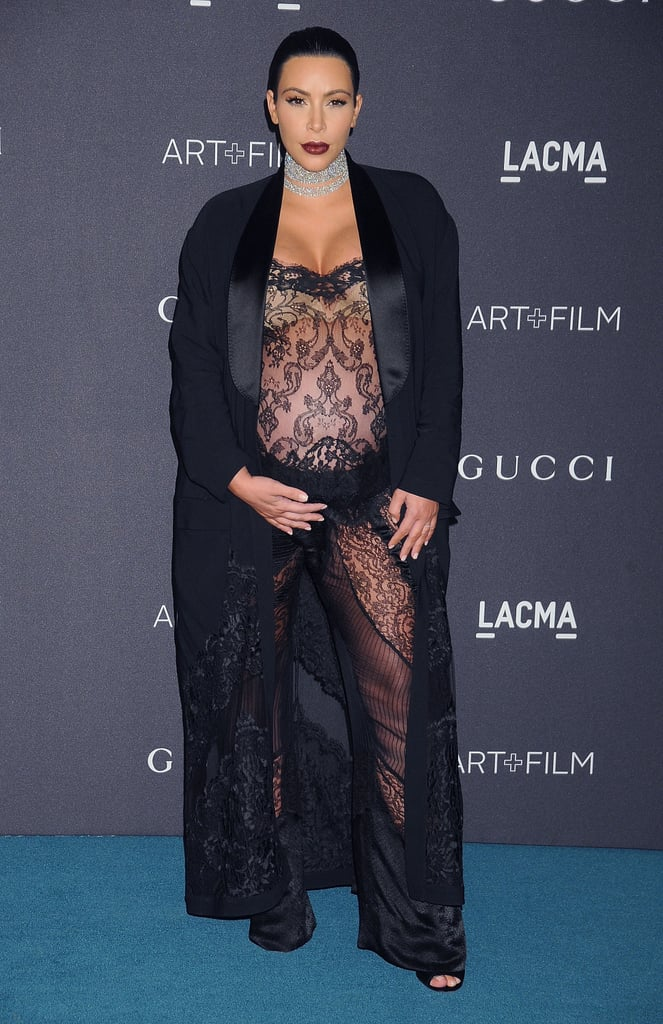 Kim stunned at the LACMA Art and Film Gala wearing a black lace Spring '16 Givenchy jumpsuit and a long satin robe. She finished her outfit with a sparkling diamond choker.