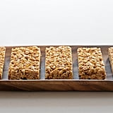 "1. Pack granola bars, dried fruits, and nuts: These snack essentials will curb your hunger if you're on a flight that doesn't serve food. You likely have one or all these items at home, so toss them in a Ziploc bag, stuff them in your duffel, and you're good to go.  2. Head straight to a smoothie or frozen yogurt spot: Bypass popular chains like McDonald's or Dunkin' Donuts when you want on-the-go breakfasts and fill up on a filling smoothie instead. If you do succumb to your Dunkin' habit, choose the egg white veggie flatbread over a sugary muffin. 3. Make your own inflight ""protein plate"": You've likely noticed when you order the protein plate on flights you typically receive an assortment of cheese, grapes, and boiled egg. Instead of overpaying for a snack pack, prep your own version and include your favorite cheese slices.  4. Make your own sandwich or bagel: It's easier to choose the less-fatty options when you're in charge of the ingredients. Even though you are still consuming carbs, you can balance that out with fillings like lettuce, tomatoes, spinach, eggs, or turkey; check out these ideas of how to make a healthy sandwich.  5. Bring an empty thermos and tea bags: Fight the urge to grab a coffee or soda to stay caffeinated before and during your flight. Instead, opt for green tea or one of your favorite varieties. All you need is hot water, which you can get anywhere in the airport and on the flight."