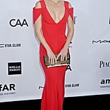 Kate Hudson accessorized her very sexy Prabal Gurung gown with a gold-studded black clutch.