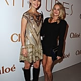 Arizona Muse toughened up her gold embellished minidress with slick knee-high boots for the Chloé 60th anniversary party.