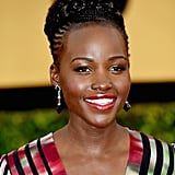 Lupita Nyong'o smartly chose black and silver drop earrings by Fred Leighton to complement her striking graphic-print dress.