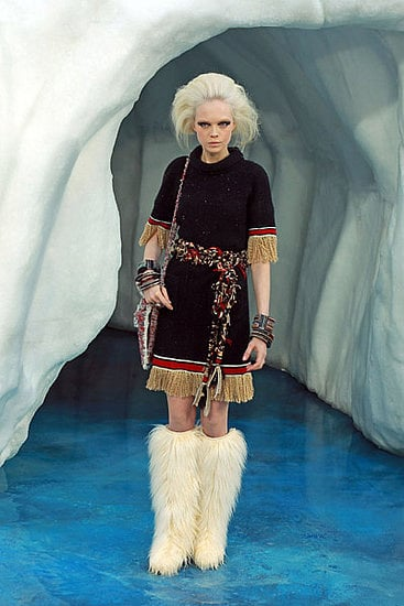 You get the impression that whatever Karl wants, Karl gets. In this Chanel Winter collection's case, that would be icebergs flown in from Scandanavia to create a frozen runway sculpture. What, are you suprised? Let's not forget he did give us a barnyard complete with hay for Spring so it's not all that crazy. If you like your Winter clothing a tad on the fuzzy side, you're in luck. Karl created a furry-licious collection complete with shaggy boots, coats, shoes and even short shorts. But get this, it was all fake. Yep, vive le faux fur! Texture featured heavily throughout most pieces, with key fabrics such as tweed, cosy mohair, and twisted fringing updating classic Chanel silhouettes and separates. Luxurious, extravagant and just a tad OTT, take a walk through our top ten looks from Chanel's Winter '10 show.