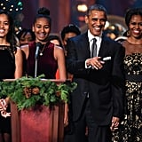 The Obama family was all smiles when they took the stage together for TNT's Christmas in Washington event at the National Building Museum in December 2014.