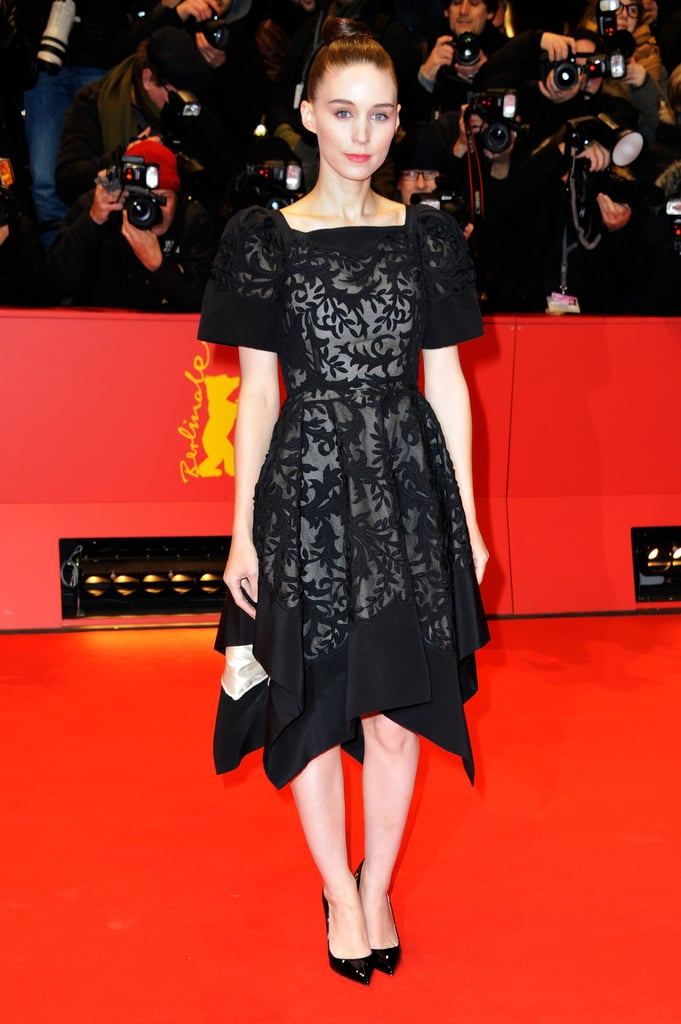 But on the red carpet, she revealed her exquisite Valentino Couture dress, complete with a square neckline and asymmetrical hem.