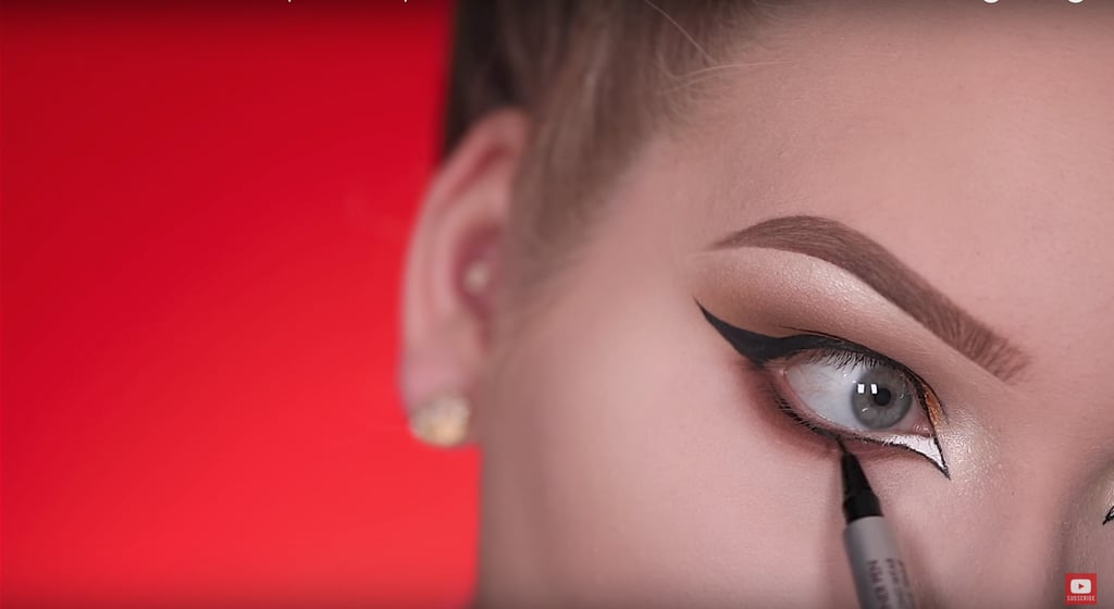 Line your lower lashes with liquid liner.