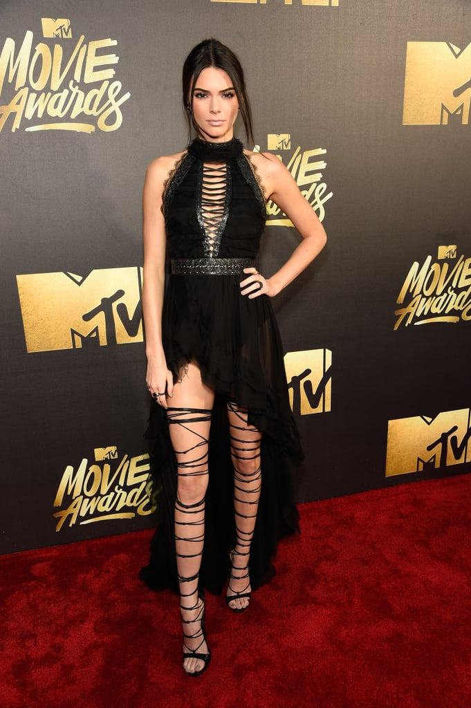 It's almost as if Kendall Jenner gets hotter by the second. On Sunday, the reality TV star took a break from her modelling duties and attended the MTV Movie Awards in LA. On top of turning heads in a gorgeous high-low dress complete with thigh-high gladiator heels, Kendall served up some serious face on the red carpet and even stopped to sign autographs for fans. Kendall's latest outing comes just days after her action-packed family holiday in Colorado and her brother Rob's controversial engagement to Blac Chyna. Read on to see more of Kendall's night, and then check out her guide to a superhot Instagram account.