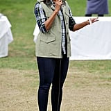 If you think Michelle only opts for one Converse silhouette, think again. She rocked her high-top Chucks with a military green vest and flannel at the White House Garden in October 2016.