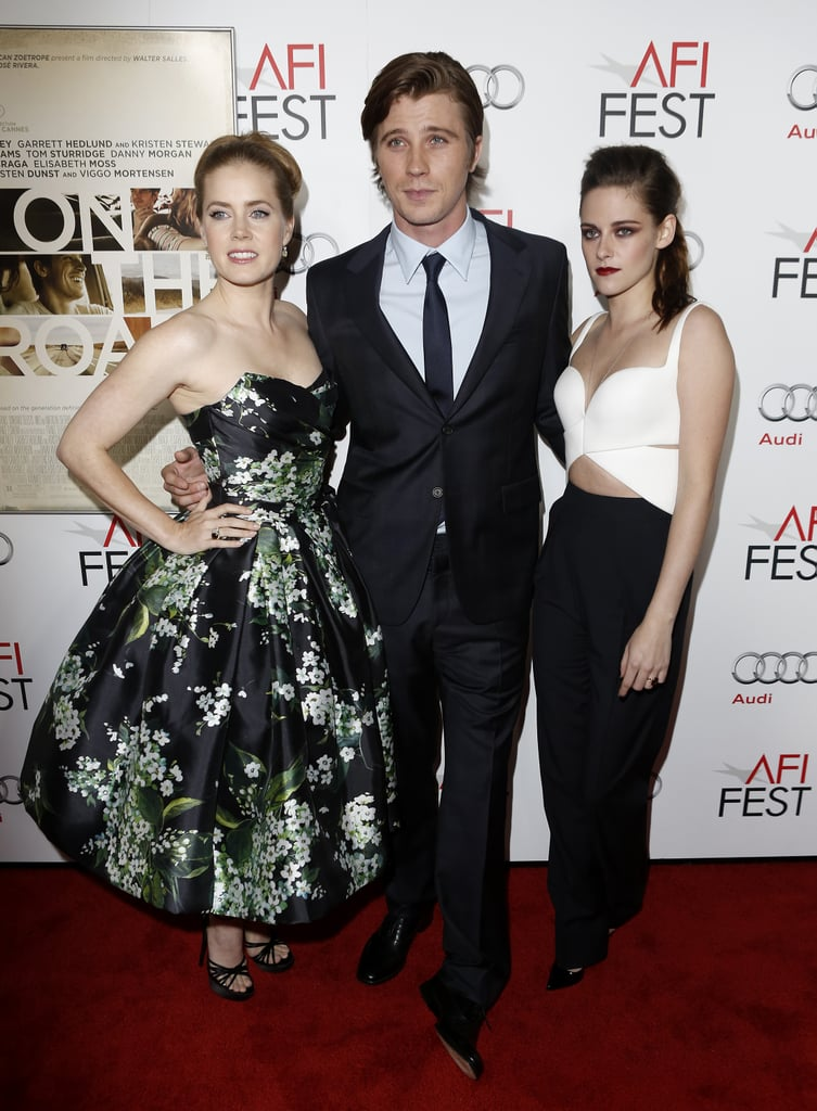 Kristen Stewart vamped it up for the premiere of On the Road at the AFI Fest presented by Audi, in LA on Saturday night. Kristen has been in Breaking Dawn Part 2 promotional mode for the past week, but she switched gears to support her indie project alongside two of her costars, Garrett Hedlund and Amy Adams. After introducing the film to the crowd at Grauman's Chinese Theatre, Kristen headed over to the afterparty at the Roosevelt. Kristen changed from her red carpet look into a leather jacket and jeans and was joined by boyfriend Robert Pattinson. Kristen and Robert have been more openly affectionate and sweet during this final Twilight press tour. The big LA premiere is Nov. 12, and before then, we can expect many more interviews and appearances together. They still have time for fun, however, and were spotted holding hands and wearing masks at a Halloween party last week.