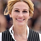 Julia Roberts wore her hair loose and tied back, with darkly-lined eyes, for a Money Monster photocall.