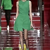 The green Versace tank dress, complete with a pleated skirt, made its debut on the Fall '15 runway styled with a statement choker and matching ankle-strap heels.