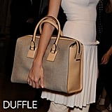 Why we love it: The duffle or bowler has just a hint of the menswear vibe. They're the shape of the old doctor's bags we love, adding interest and polish — and they look even better held just in the crook of your wrist, soaking up all the attention. How to wear it: These bags go anywhere and look great with just about anything. They dress up even our most basic looks, like our jeans and t-shirts, and look even better in worn-in leathers.  Photo:Victoria Beckham Spring 2012