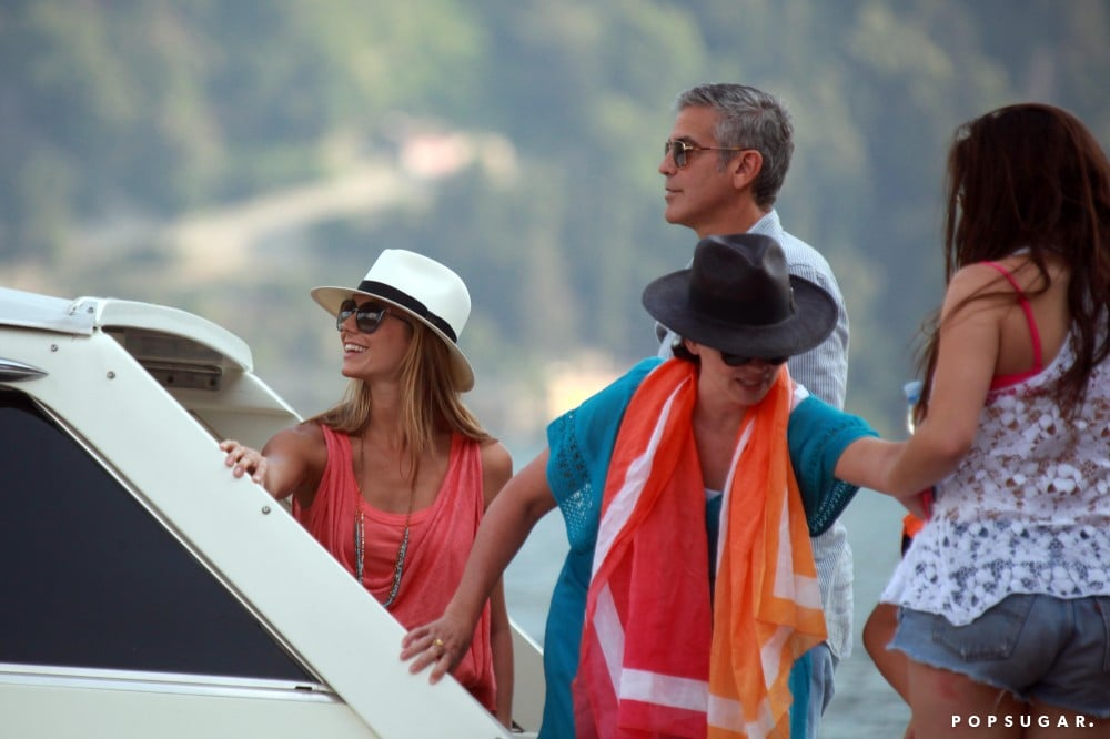 Stacy Keibler and George Clooney took in the sights while boating with friends, including George's ex Karen Duffy, around Lake Como in July 2012.