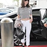 Olivia Munn Carrying a Valentino Rockstud Tote Bag