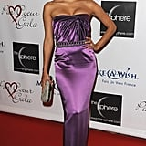 For the 2009 Par Coeur Gala, Eva Longoria radiated glamour in a formfitting thistle-hued gown embellished at the waist. She rounded out her high-octane look with jeweled chandelier earrings and a sparkling clutch.
