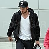 Robert Pattinson looked handsome when he touched down at LAX.