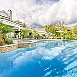 The backyard is nothing short of a resort with a sprawling pool and spa.
