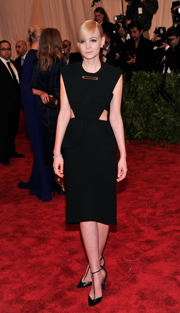 Carey Mulligan went for a sleek, streamlined look tonight on the Met Gala red carpet. The Great Gatsby actress wore a design by Alexander Wang, who just took the reins at Balenciaga this season. The dress featured a midriff-baring panel and a nod to the night's theme, Punk: Chaos to Couture, with its safety-pin detail on the chest.  Carey has been in NYC lately prepping for the release of The Great Gatsby. At the premiere of the movie last week, she told us the elaborate costumes on set made her nervous and even admitted to accidentally breaking some pieces of jewelry during shooting. Carey's outfit tonight was a far cry from the flapper-inspired costumes she wears as Daisy Buchanan in the film. Tell us what you thought of her choice, and the rest of the many red carpet looks from the event, in our 2013 Met Gala polls!