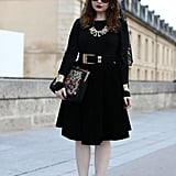 Statement add-ons give her ladylike dress a lot more character.