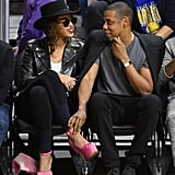 Jay Z held on to Beyoncé's ankle as they checked out the Golden State Warriors game in February 2016.