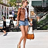 Gigi Hadid took her cutoffs uptown with a tailored leather jacket and slides.