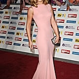 At the 2011 Pride of Britain Awards, Cheryl debuted a new hairdo and a killer Victoria Beckham gown.